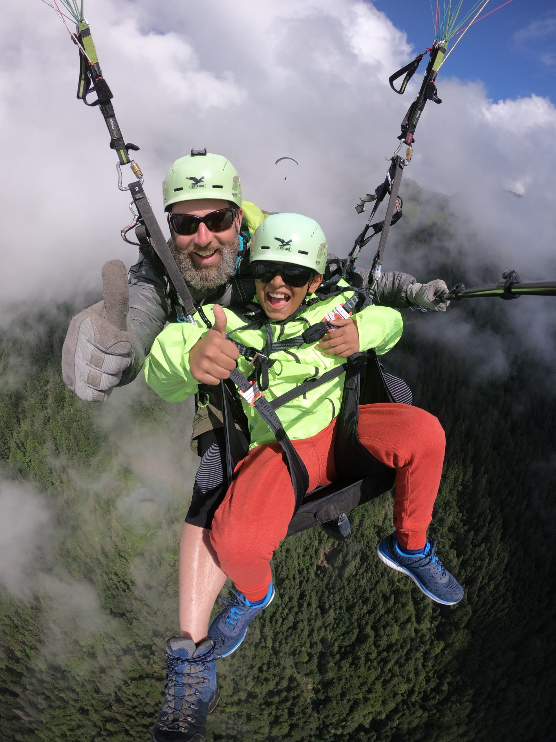 Paragliding with kids Interlaken big smiles thumbs up - Copy